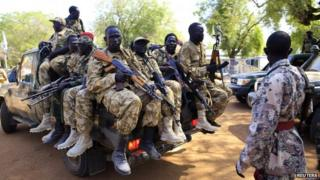 South Sudan army soldiers hold their weapons as they ride on a truck in Bor, 180 km (108 miles) northwest from capital Juba December 25, 2013