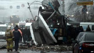 Russian firefighters and security personnel inspect the destroyed trolleybus in Volgograd