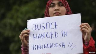 """A supporter of the Pan-Malaysian Islamic Party (PAS) protests against the hanging of Bangladesh""""s Jamaat Islamic Party leader Abdul Quader Mollah outside the Bangladesh embassy in Kuala Lumpur December 27, 2013"""