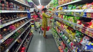 A woman shopping in a supermarket in India