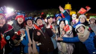 Revellers celebrate the new year following a count-down event at the Summer Palace in Beijing on 1 January 2013