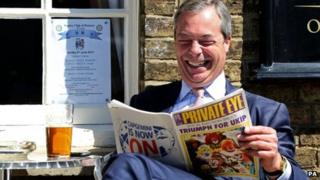 UKIP leader Nigel Farage laughs while reading a copy of Private Eye in May