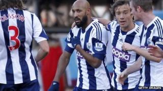 "West Bromwich Albion's Nicolas Anelka performs a ""quenelle"" after scoring a goal on December 28, 2013."