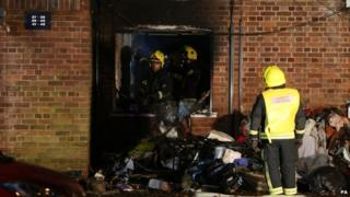 Firefighters clear out remains of home which was on fire