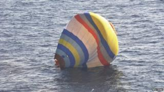 A hot-air balloon drifting in the East China Sea near the disputed isles known as Senkaku in Japan and Diaoyu in China, in a photo released 2 January 2014