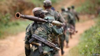 DR Congo soldiers patrol near Beni in North Kivu province on 31 December 2013