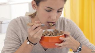 Girl eating cereals