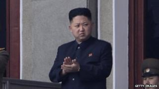 North Korean leader Kim Jong Un applauds during an official ceremony on April 14, 2012.