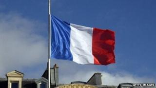 A French flag flies at half mast over the Elysee presidential palace.