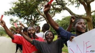 Frank Bwalya (C in red) and supporters at a protest in Lusaka, Zambia, on 22 March 2011