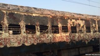 The charred coach of the Dehradun Express. 8 January 2013