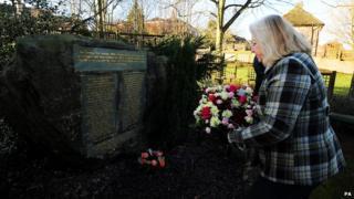 Lesley Pendleton lays flowers at the Kegworth air disaster memorial
