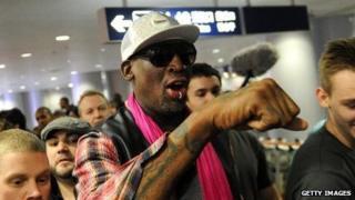 Dennis Rodman checks in for his flight to North Korea at Beijing's international airport.