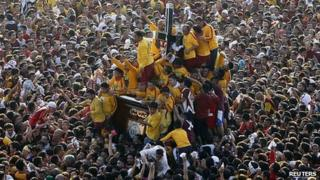 Devotees crowd around the Black Nazarene statue in Manila