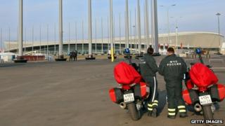 Security personnel stand next to their motorbikes outside the Olympic Park in Sochi (9 January 2014)