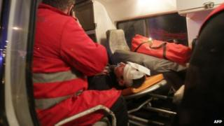 Yuriy Lutsenko lies injured in an ambulance after the clashes in Kiev (11 January 2014)