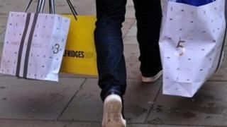 A man carrying bags of shopping