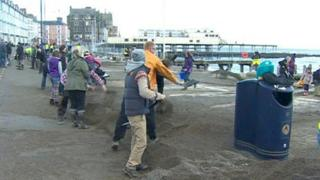 Volunteers clean up at Aberystwyth's storm-damaged seafront
