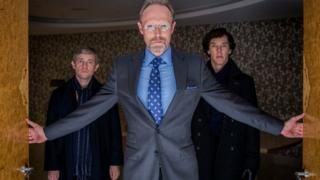 Martin Freeman as John Watson, Lars Mikkelsen as Charles Magnussen and Benedict Cumberbatch as Sherlock Holmes