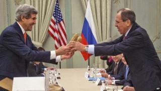 US Secretary of State John Kerry (left) gives a pair of Idaho potatoes to his Russian counterpart Sergei Lavrov