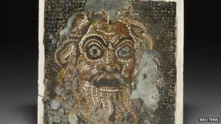 """A comic mask mosaic, one of the exhibits in """"Life and death in Pompeii and Herculaneum"""