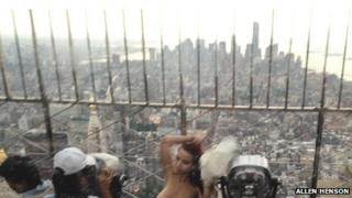 Model Shelby Carter is photographed topless atop the Empire State Building on 9 August 2013