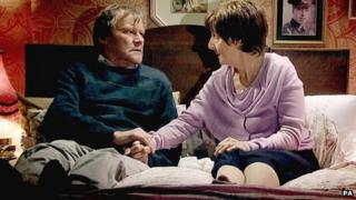 Coronation Street scene featuring Hayley and Roy Cropper, played by Julie Hesmondhalgh and David Neilson.