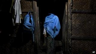 In this 15 September 2013 photo, a woman who claims she was raped by Myanmar security forces stands in her home in Ba Gong Nar village, Maungdaw, northern Rakhine state, Myanmar