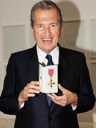 Mario Testino with his honorary OBE