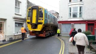 Train being moved through streets of Barmouth, Wales