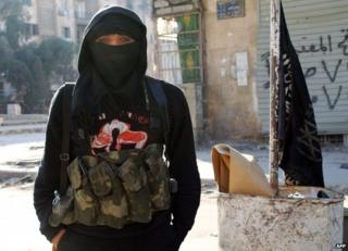 A member of the al-Nusra militant group in Aleppo, Syria, 11 January