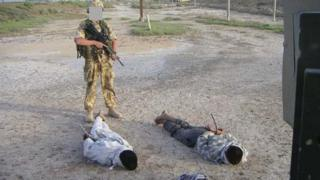 Iraqis being guarded by British soldier
