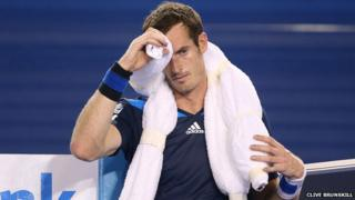 Andy Murray cools himself down during his match