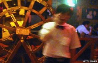 A waiter in a Beijing nightclub