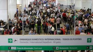 Passengers wait for flights at Brasilia international airport, in Brasilia, Brazil on 28 November 2013