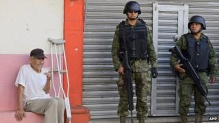 Mexican soldiers patrol the streets of Apatzingan, Michoacan. Photo: 16 January 2014