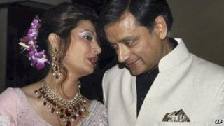 Shashi Tharoor listens to his wife Sunanda Pushkar at their wedding reception in Delhi, September 2010