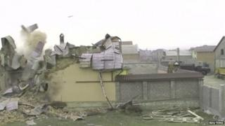 A still image from a handout video shows a building destroyed during an anti-terrorism operation in Dagestan, January 18