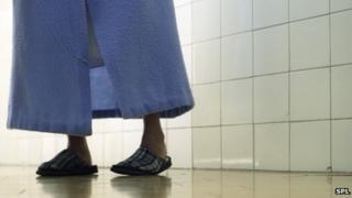 Elderly patient in gown