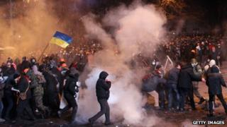 Protesters clash with riot police during an opposition rally in the centre of Kiev