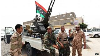 Heavily armed militia surrounding the Libyan Justice Ministry in April 2013.