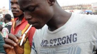 A man smoking in Lagos state, January 2012