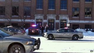 Police cars are seen outside Purdue University in West Lafayette, Indiana, on 21 January 2014