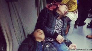 Travellers on a train in China before the Chinese New Year celebrations