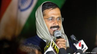 Delhi's Chief Minister Arvind Kejriwal talking to journalists at his sit-in on 21 January