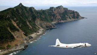 A 2011 file photo shows a Japanese surveillance plane flying over the disputed islands in the East China Sea