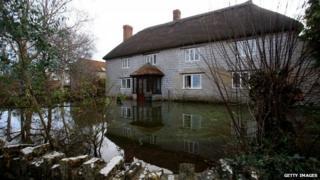 Flood water surrounds house in the village of Muchelney