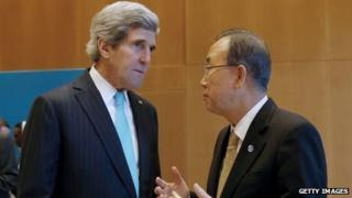 US Secretary of State John Kerry (L) listens to UN Secretary-General Ban Ki-moon prior to peace talks in Montreux