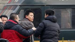 Zhang Xuezhong (centre), a lawyer for Zhao Changqing, outside a Beijing court, 23 January 2014