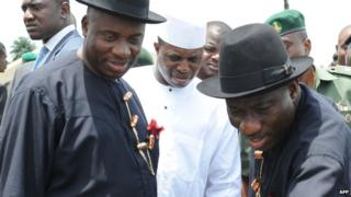 Rivers state governor Rotimi Amaechi (L) and President Goodluck Jonathan (R)